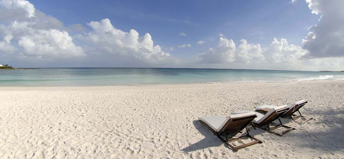 Tropical beach with deck chairs